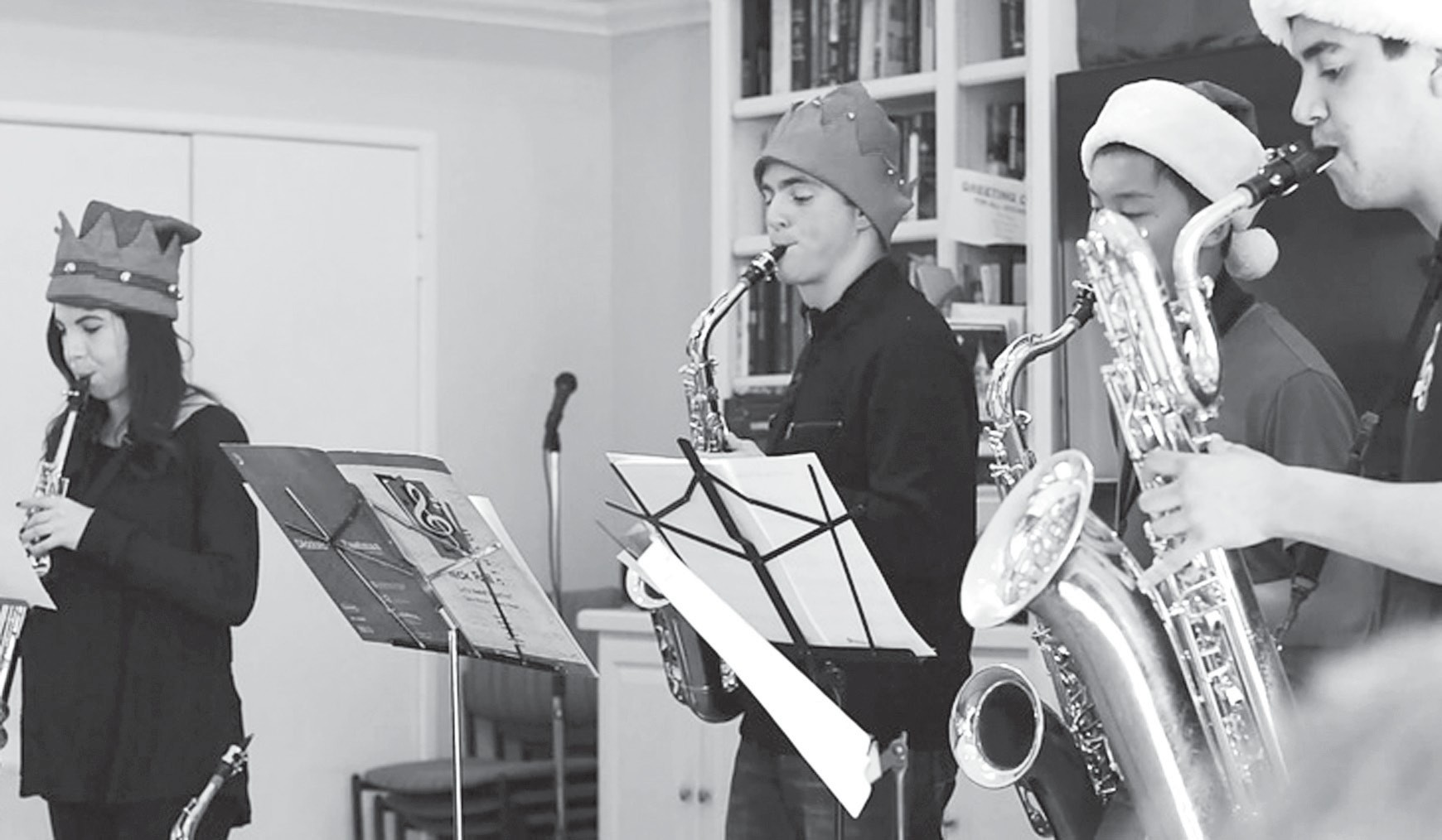 SOOTHING SOUNDS—A Harmonic Remedy saxophone players perform at a previous holiday function for senior citizens:. From left: Samantha Shapiro, James Ioannou, Nhat (Tintin) Nguyen and Kellen Fujishin. Courtesy of Quynh-Anh Nguyen