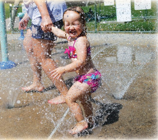 COOL KIDS—Emma Glasgow, 2, of Sherman Oaks beats the heat at the Oak Canyon Community Park splash pad Sept. 3 in Oak Park. Temperatures have fallen and will stay in the mid-80s into next week. BOBBY CURTIS/Acorn Newspapers