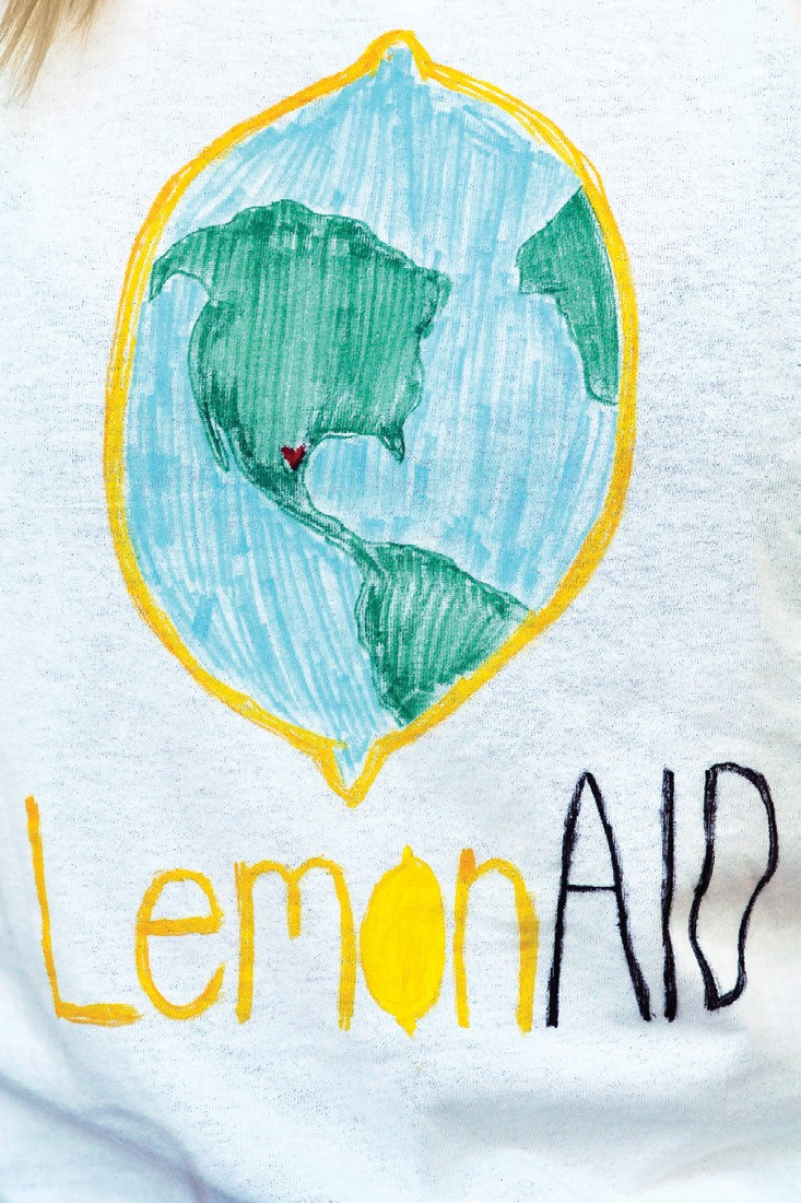 T- SHIRTS FOR TEXAS— Westlake Village resident Bodee Lee creates shirts for the volunteers working at a lemonAID stand to raise funds for Hurricane Harvey victims relief.