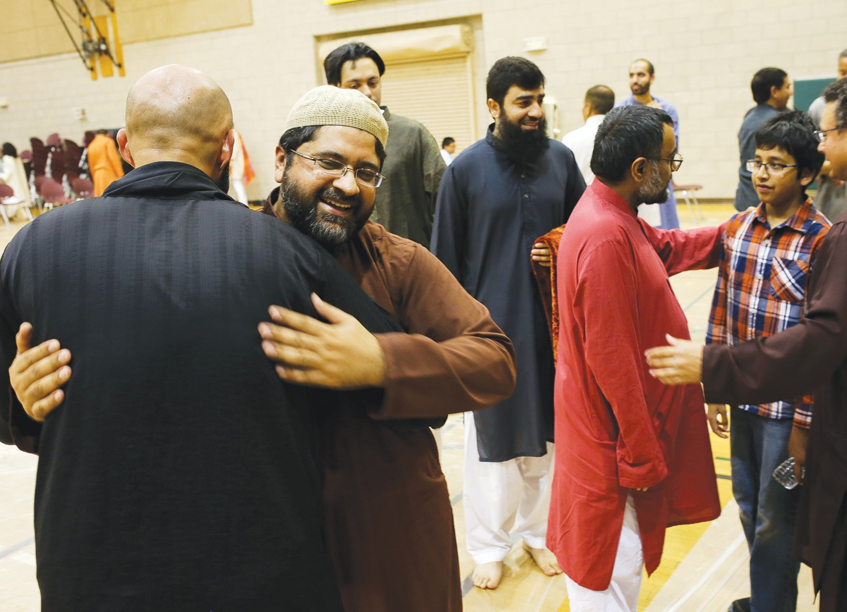 BLESSED CELEBRATION—Shahid Iqbal, right, of Oak Park and Hamza Jilani of Agoura Hills greet one another after prayer during Eid-al-Adha on Sept. 1 at Dos Vientos Community Center in Newbury Park. BOBBY CURTIS/Acorn Newspapers