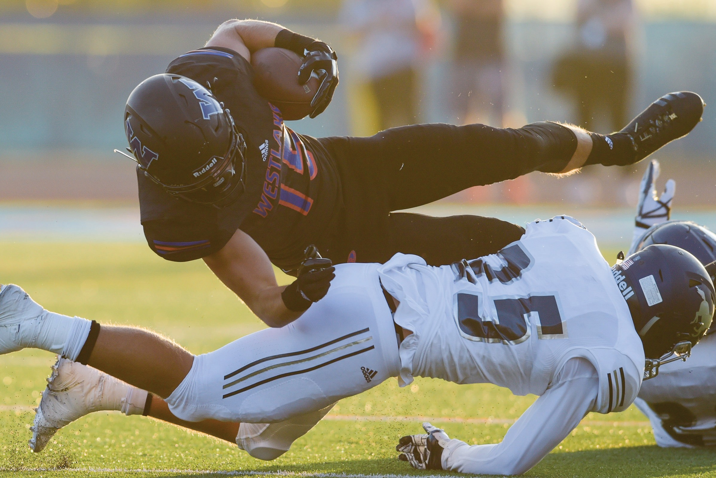 CROSSTOWN TRAFFIC—Westlake High receiver Michael Carner fights for yards against Sierra Canyon on Aug. 25 at home. Carner and the Warriors play at Newbury Park on Friday in a Conejo Valley clash. MICHAEL COONS/Acorn Newspapers