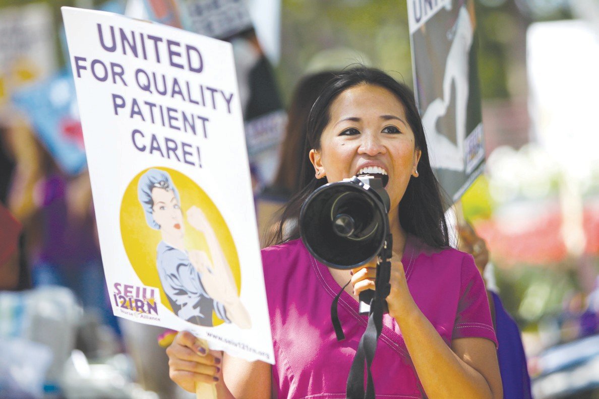 HELP WANTED—Jennifer Hardy, an intensive care unit nurse, leads the picket line during a protest outside Los Robles Hospital in Thousand Oaks on Monday. Nurses were picketing due to poor working conditions they say have been caused by staffing shortages. BOBBY CURTIS/Acorn Newspapers