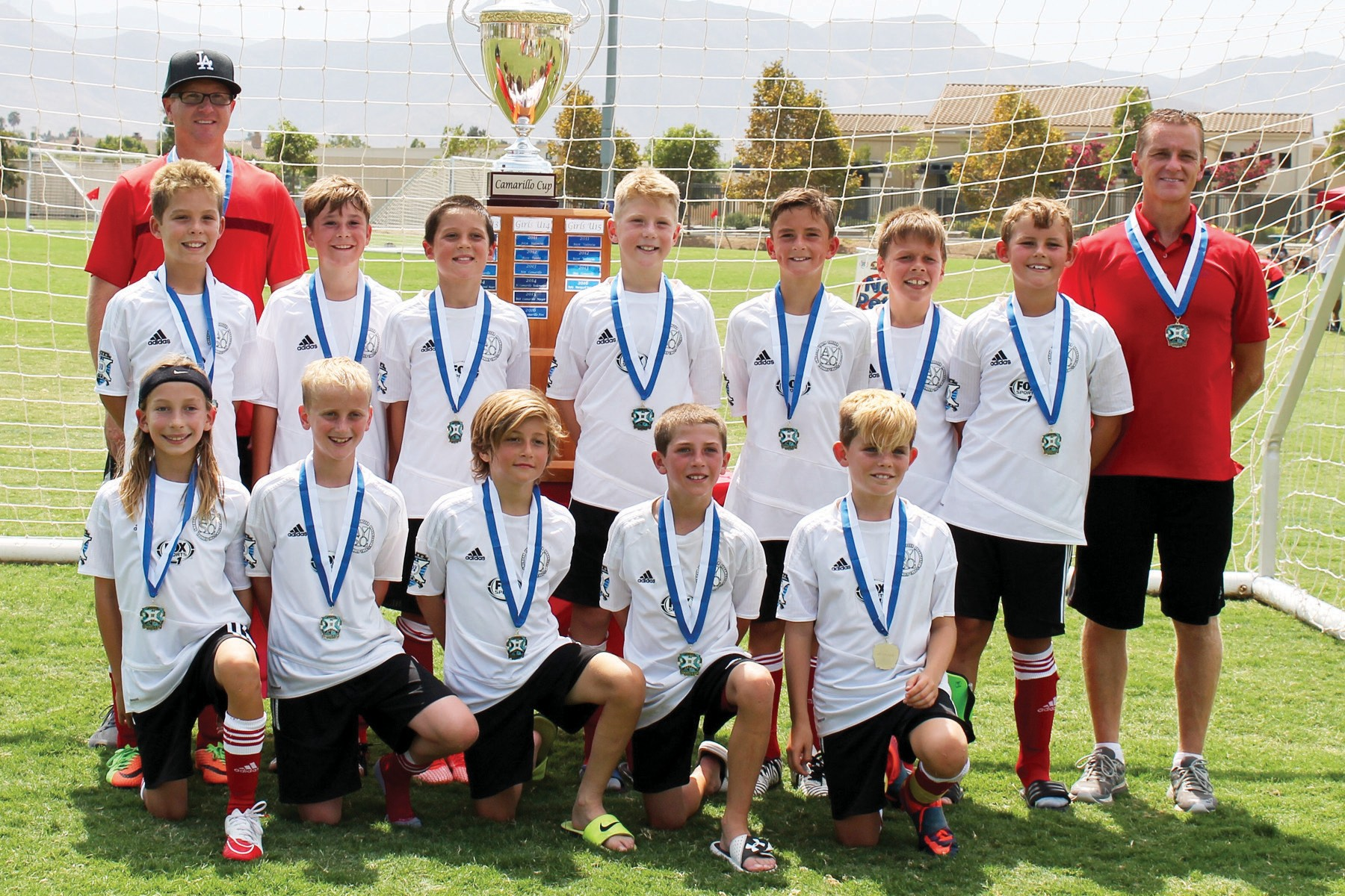 SOCK IT TO 'EM— Left, the Red Devils boys' AYSO Extra Team are the 2017 Camarillo Cup champions for the second year in a row. Back row, from left: Coach Brian Oliver, Cooper McAllister, Will Fox, Brady Dieffenbach, Braden Oliver, Jesse Leko, Josh Mensching, Garrett Andrews and coach Alan Howie. Front row: Cayde Rooke, Connor Howie, Shai Stabinsky, Caden Graves and Alex McAllister.