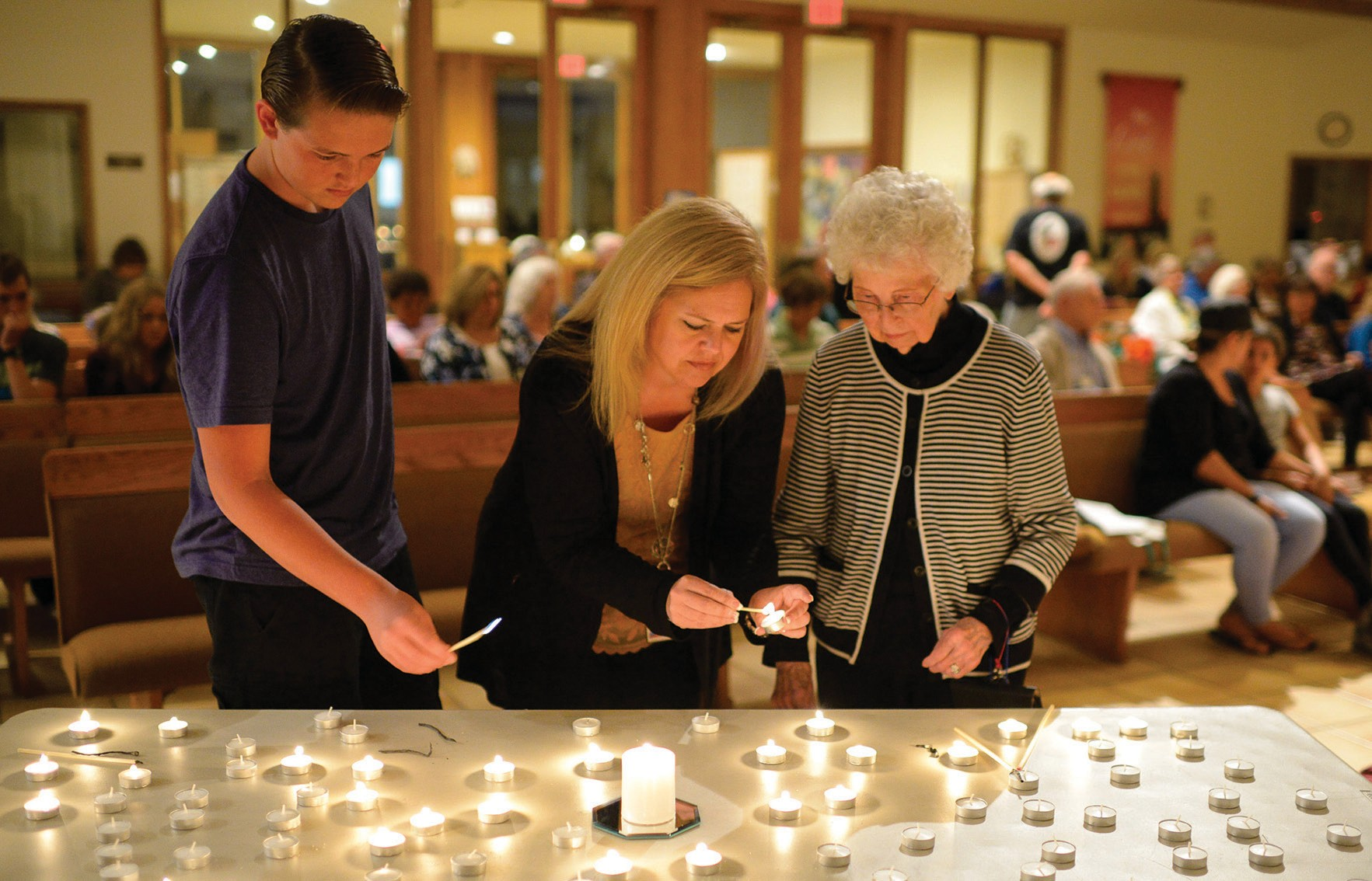 PRAYER VIGIL—Mourners gather at Holy Trinity Lutheran Church in T.O. MICHAEL COONS/Acorn Newspapers