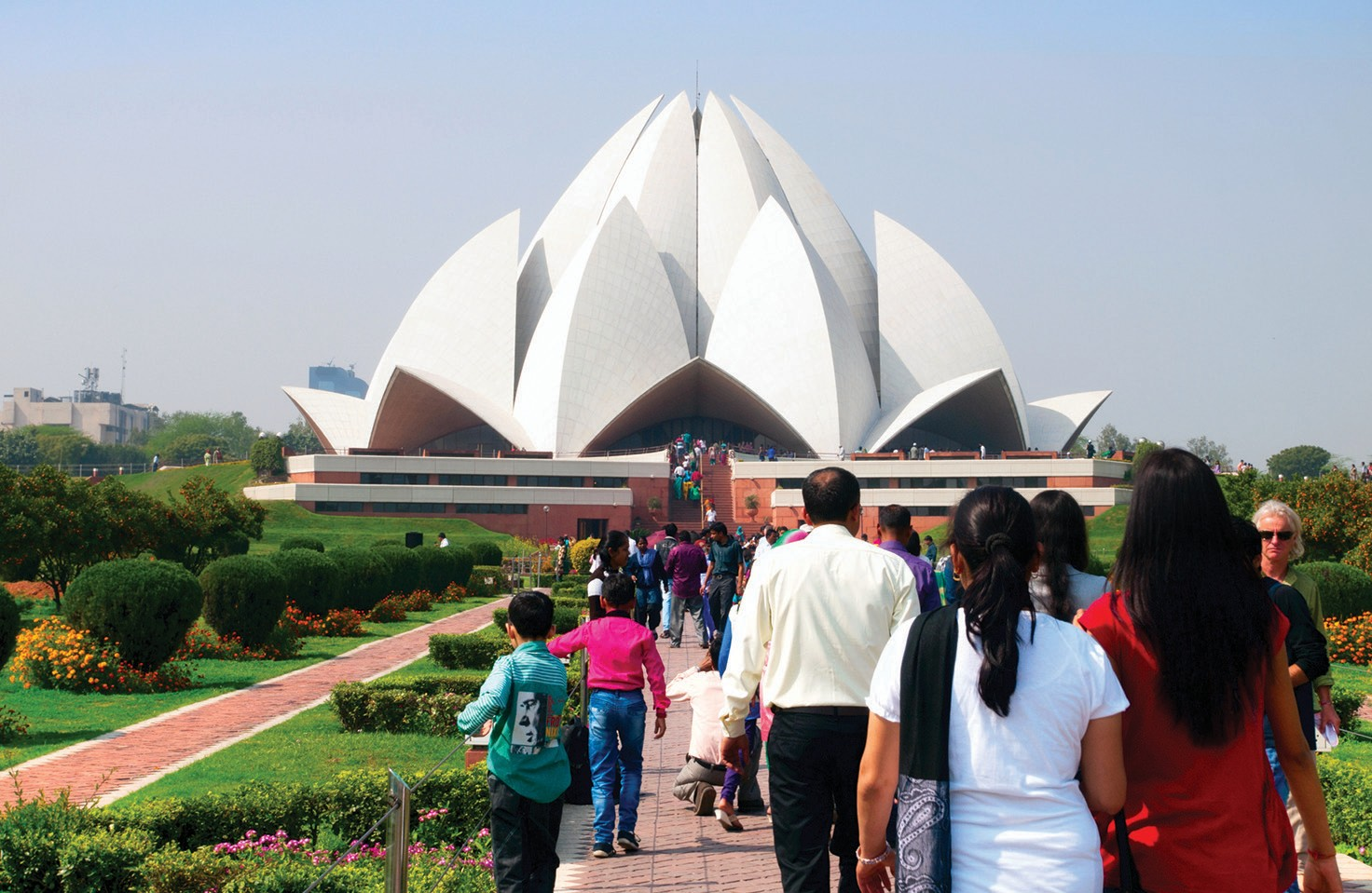 OPEN TO ALL—People visit the Lotus Temple, a Bahá'í house of worship completed in 1986, in New Delhi, India. This month the local Bahá'í community will honor the founder of the faith with two events open to the public.