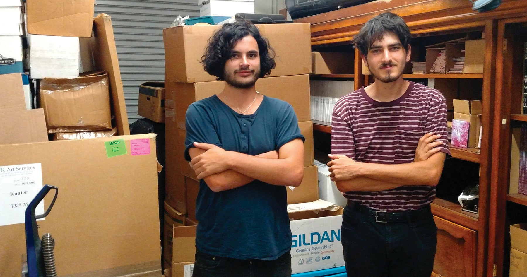 YOUNG ENTREPRENEURS—Co-owners of Danger Collective Records, Jai Chebaia, left, and Reed Kanter, along with some of the company's inventory. IAN BRADLEY/Acorn Newspapers