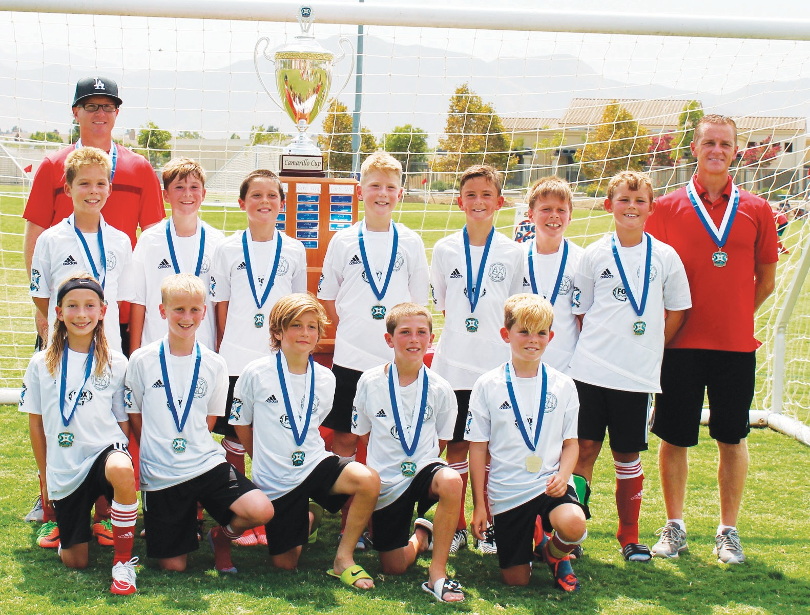 RED HOT—The Red Devils, the 2007 boy's Agoura AYSO Extra team, are the 2017 Camarillo Cup Champions for the second year in a row. Back row from left: Coach Brian Oliver, Cooper McAllister, Will Fox, Brady Dieffenbach, Braden Oliver, Jesse Leko, Josh Mensching, Garrett Andrews and coach Alan Howie. Front row kneeling: Cayde Rooke, Connor Howie, Shai Stabinsky, Caden Graves and Alex McAllister.