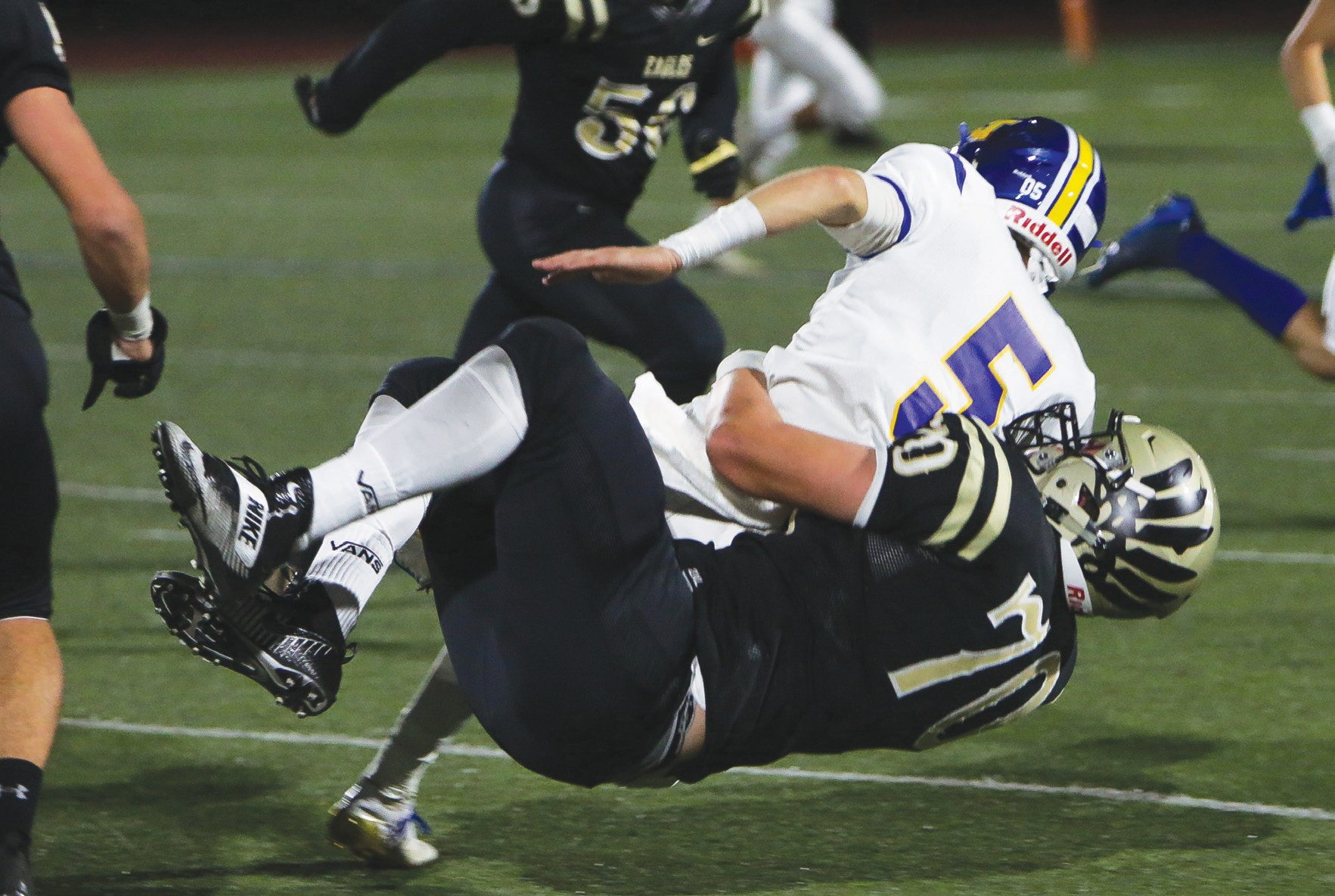 FREE FALLIN'—Oak Park High's Hunter Lee, No. 70, tackles Nordhoff's Korey Stevens during the Eagles' 22-18 win at homecoming on Oct. 6. Lee is a Division I prospect with multiple scholarship offers. BOBBY CURTIS/Acorn Newspapers