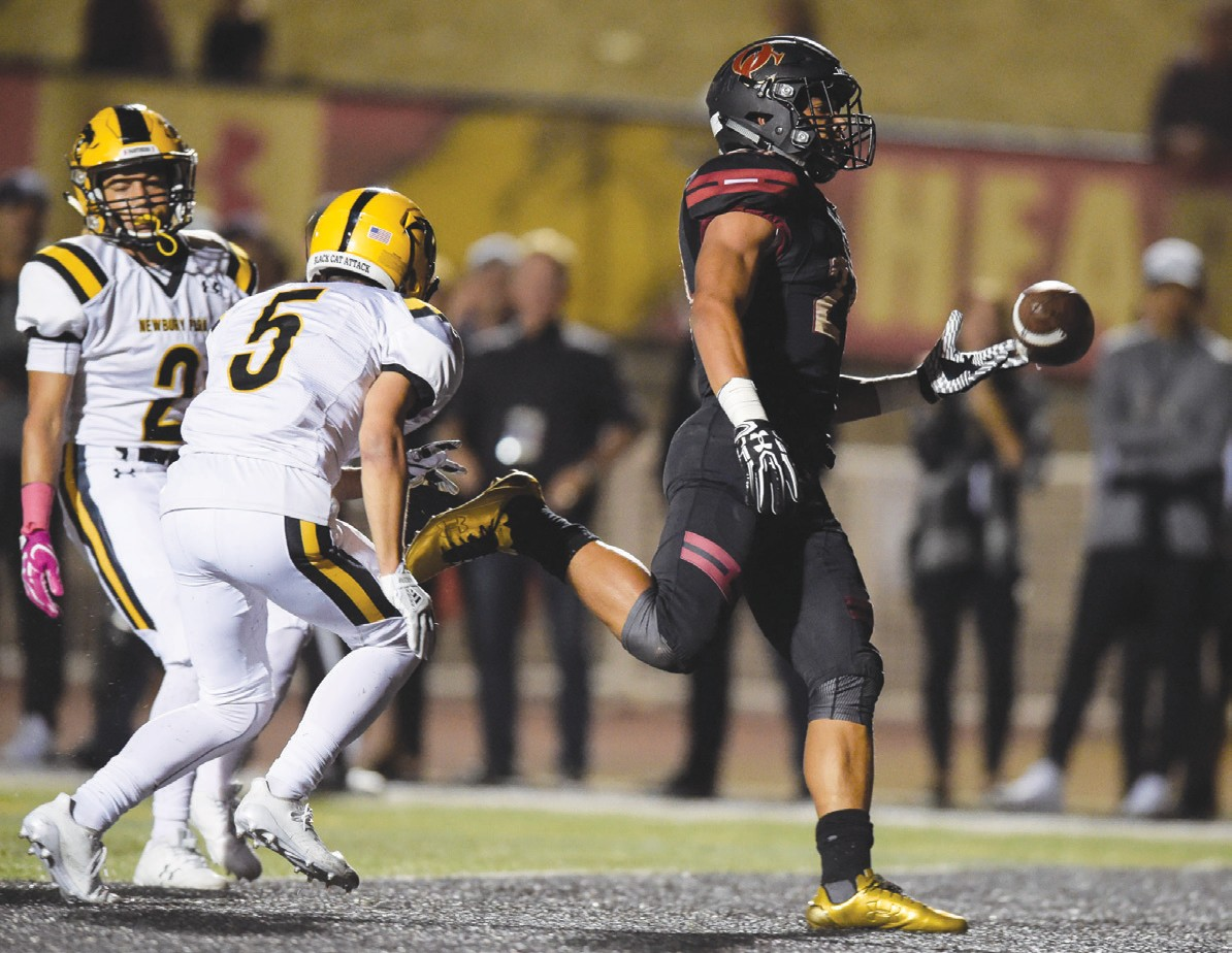 IT'S GOOD TO BE KING—Oaks Christian's Zach Charbonnet tosses the ball after scoring a touchdown against Newbury Park on Oct. 6. MICHAEL COONS/Acorn Newspapers