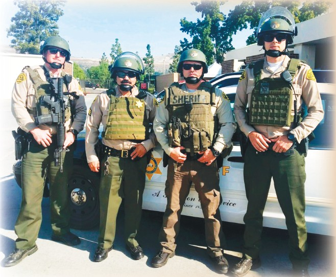 ARMED AND READY—Personnel from the Lost Hills Sheriff's Station don tactical gear for the training. Courtesy of LASD