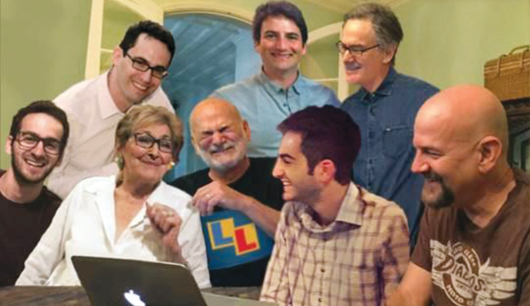 GAME TIME—The Neigher family enjoys a light moment together playing their online game titled Letterloose. Front row, from left are: Benjamin, Ethel, Steve, Alex and Rick. Back row: Eric, Clay and Geoff. Courtesy photo