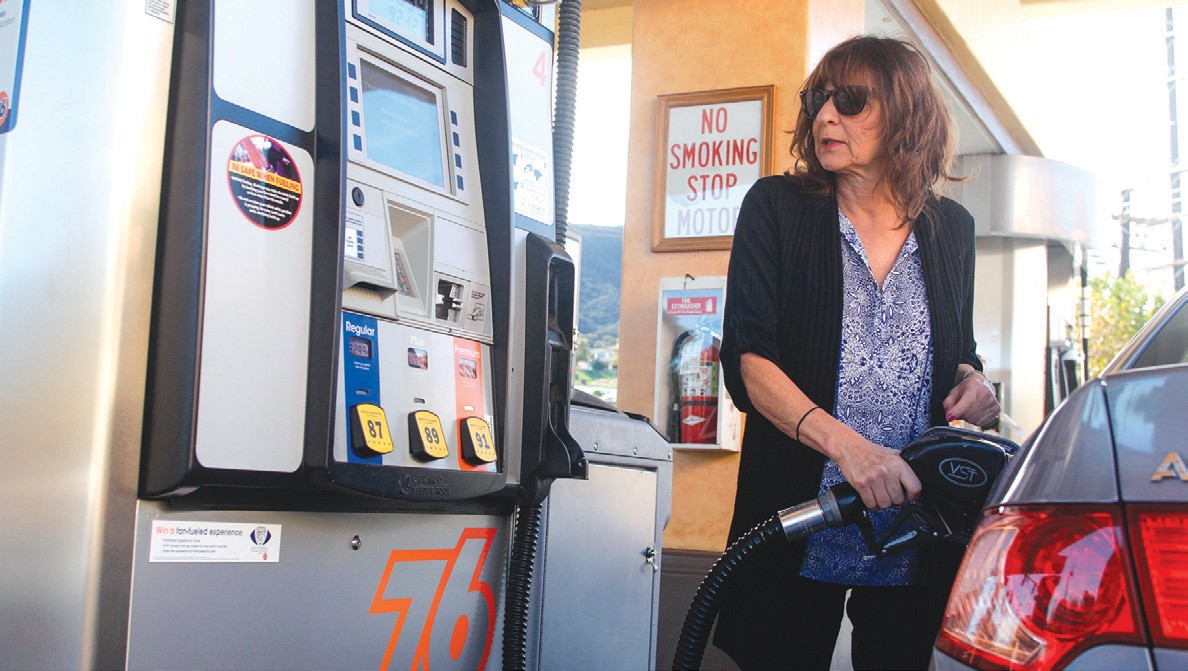 PAIN AT THE PUMP?—Bonnie Soltman of Agoura Hills keeps an eye on the gas prices at the 76 station on the corner of Canwood Street and Reyes Adobe Road in Agoura. RICHARD GILLARD/Acorn Newspapers
