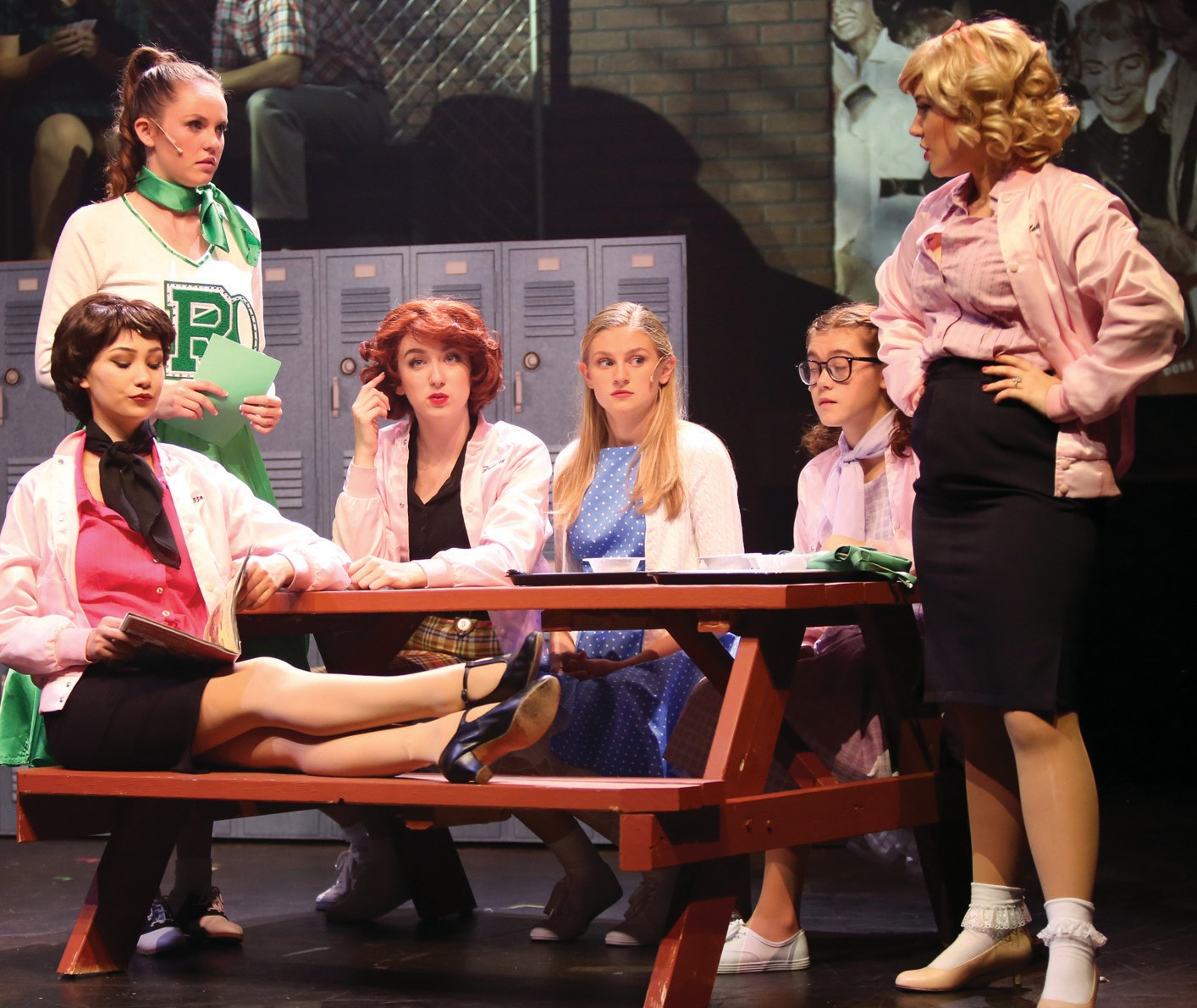 """PINK LADIES—From left, Jessica Gonzales, Haley Hallman, Nicole Fair, Jessica Bell, Camille Schwarz and Kate Fruehling star in """"Grease."""" Courtesy of Barbara Mazeika"""