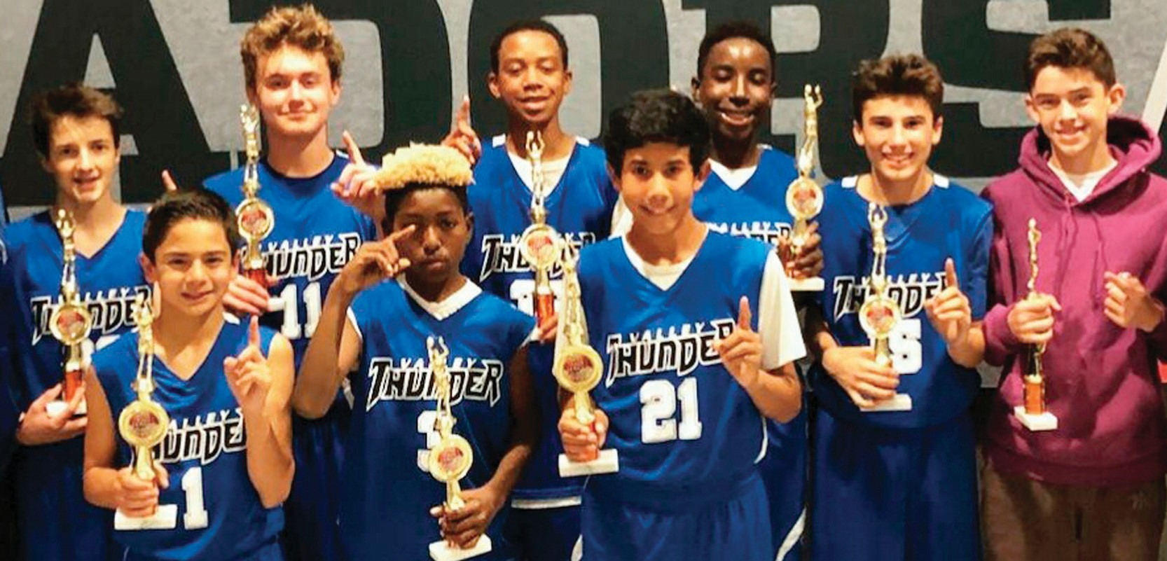 ROLLING THUNDER—Valley Thunder Basketball Club's U-14 team wins the division championship in the ARC Fall League. The team comprises players from Oak Park, Moorpark, Simi Valley, Thousand Oaks and Westlake Village. From left: Justice Nobert, Spencer Lavine, Jacob Jones, Dante Calhoun, Jacob Huggins, Jordan Alomeri, Samson Hall, Max Weiland and Niko Limbert.