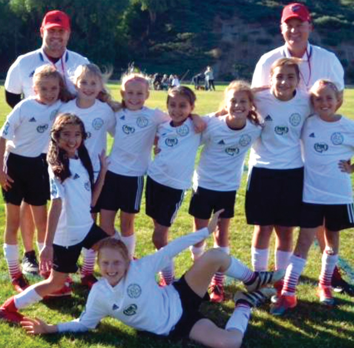 FLYING HIGH—The Red Hawks is the AYSO EXTRA 2008 girls'soccer league champion for the 2017 season. The girls won the league with a 10-1-1 record. They'll continue in January to the regional playoffs. Coaches are Scott Deck, back left, and Ryan Graves. Top row players and their school: Rian Bock (Sumac), Kelsey Graves (Oak Hills), Presley Deck (Oak Hills), Sienna Bradley (Willow), Bella Harder (Oak Hills), Sarah Manley (Red Oak), Makena Morgan (Westlake Elementary). Kneeling in front is Taylor Bessey (Oak Hills). On the ground is Audrey Simic (Westlake Elementary).