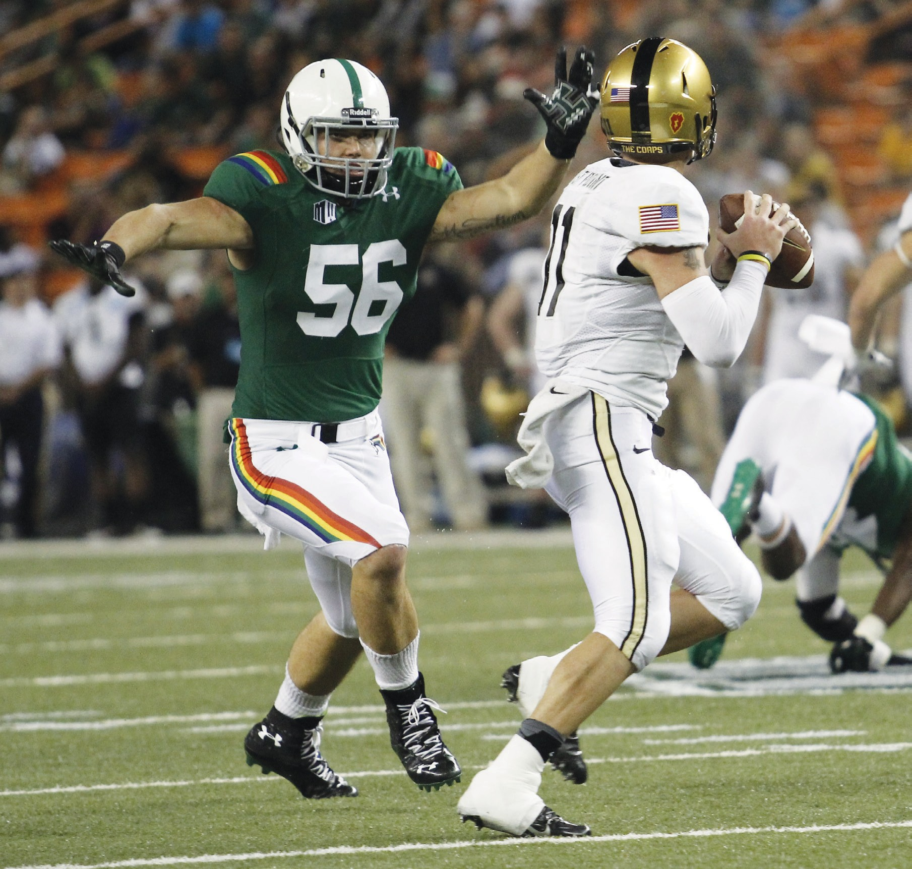 THE RAINBOW WARRIOR—Brenden Daley, a 2009 Moorpark High graduate, went on to play football for Ventura College, the University of Hawaii and the Atlanta Falcons. He earned a bachelor's degree in sociology from Hawaii, and he was working on a master's degree at the time of his death last week. Photos courtesy of University of Hawaii athletics