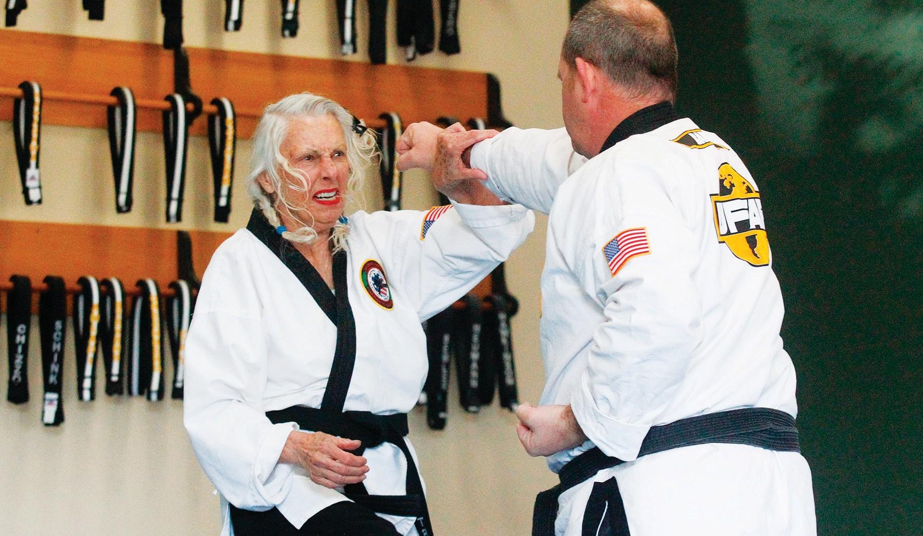 FIGHTING SPIRIT—Gale Trumbeaux, who turns 80 years old on Dec. 20, spars with Jeffery Barber during her third-degree black-belt test on Dec. 6 at Premier Martial Arts in Westlake Village. RICHARD GILLARD/Acorn Newspapers