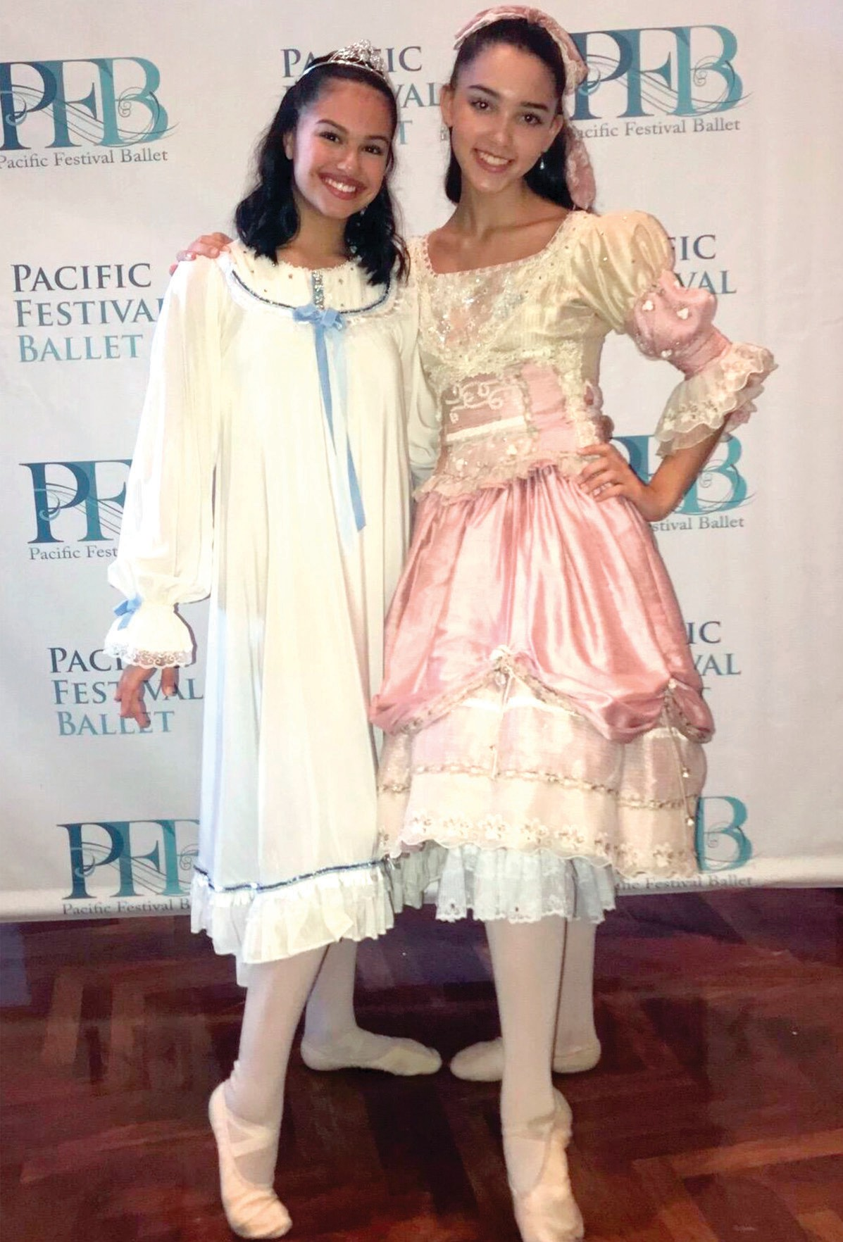ON THEIR TOES— Above, Erin Gonzales, left, and Grace Elfers will play the role of Clara in alternate performances of