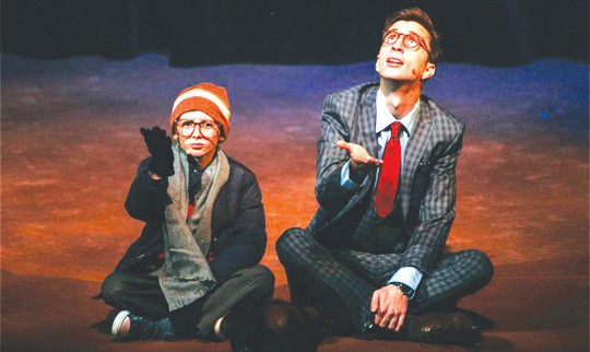 "GIFT WISH—Patrick Geringer, left, plays Ralphie and Austin Robert Miller is Jean Shepherd/narrator in the musical version of thefilm, ""A Christmas Story,"" at the Simi Valley Cultural Arts Center. Courtesy of Will Shupe"