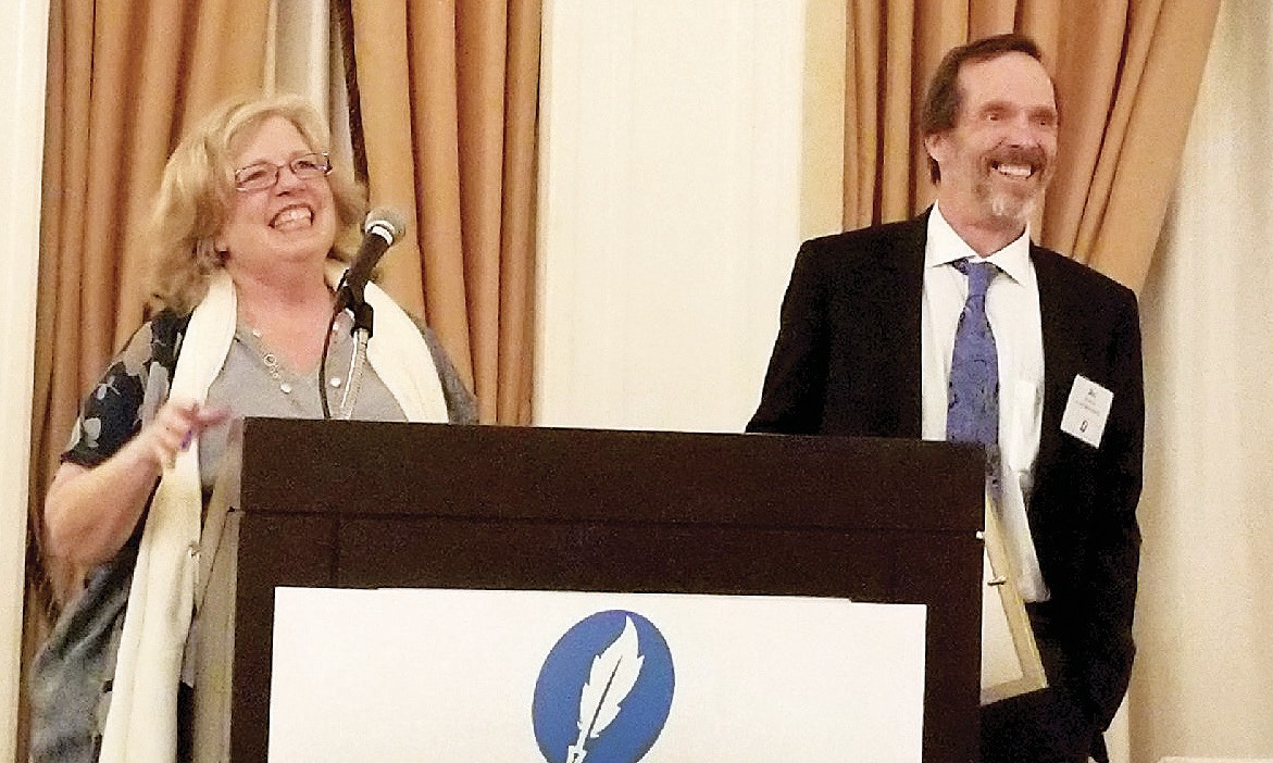 EXECUTIVE DECISION— Lisa Rule, associate publisher of the Acorn Newspapers, and Jim Rule, publisher, receive the California Press Foundation's Executive of the Year Award Dec. 1 in San Francisco. KYLE JORREY/Acorn Newspapers