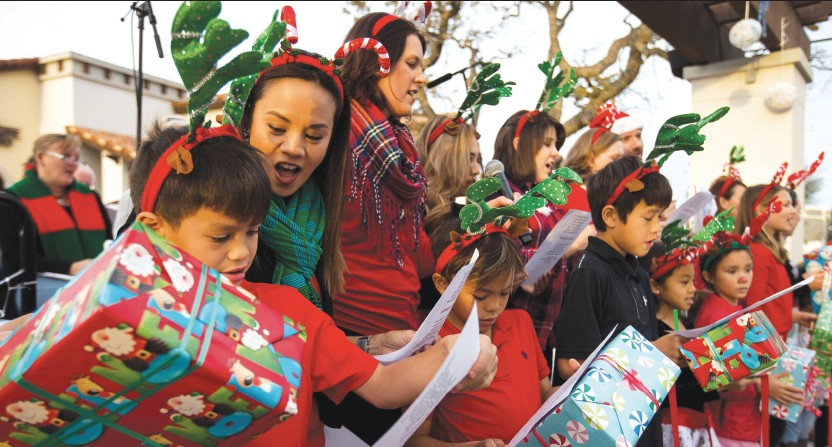 FA LA LA LA LA—Above, the Greater Conejo Valley Chamber of Commerce and friends harmonize during the second annual Holiday Sing-along Dec. 10 at The Shoppes at Westlake Village. A small choir led shoppers and passers-by in singing songs of the season.