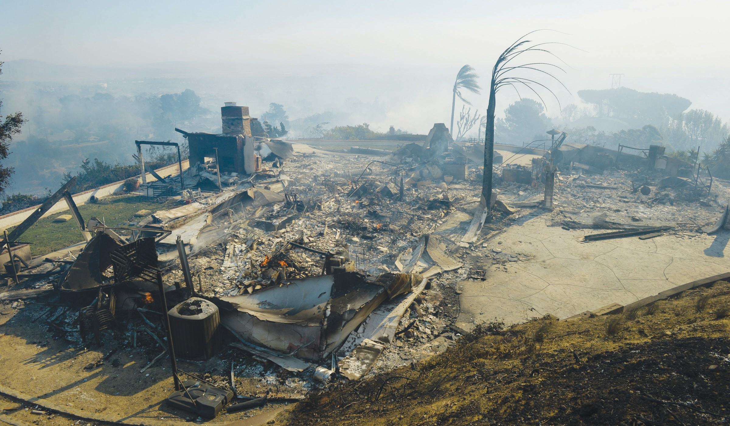 DEVASTATION—Above, in addition to destroying structures, like this Ventura house, the Thomas Fire killed countless wild animals. The now-famous rabbit at right was rescued by a man who stopped along the road. MICHAEL COONS/Acorn Newspapers
