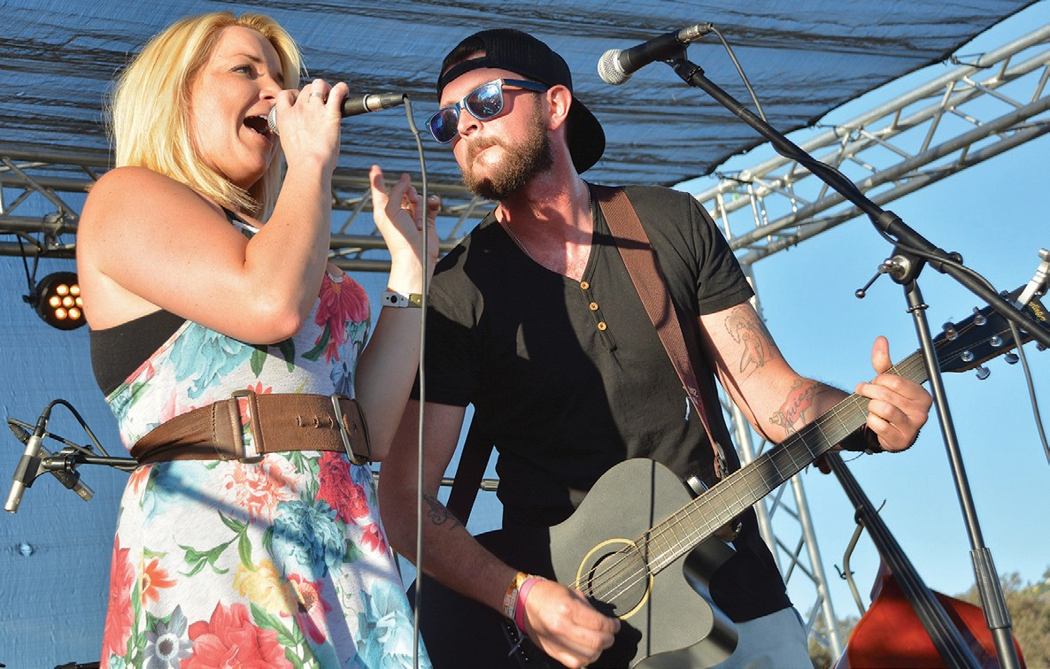 """COUNTRY TUNES—Simi Valley resident Jenna Ryin and Aaron Crankshaw of San Diego, members of country music band The Other Words, perform """"Days Like Gold"""" during at thefifth annual OakHeart Country Music Festival last June hosted by the Rotary Club of Westlake Village at Conejo Creek Park South in Thousand Oaks. SUSAN WEININGER/Acorn Newspapers"""