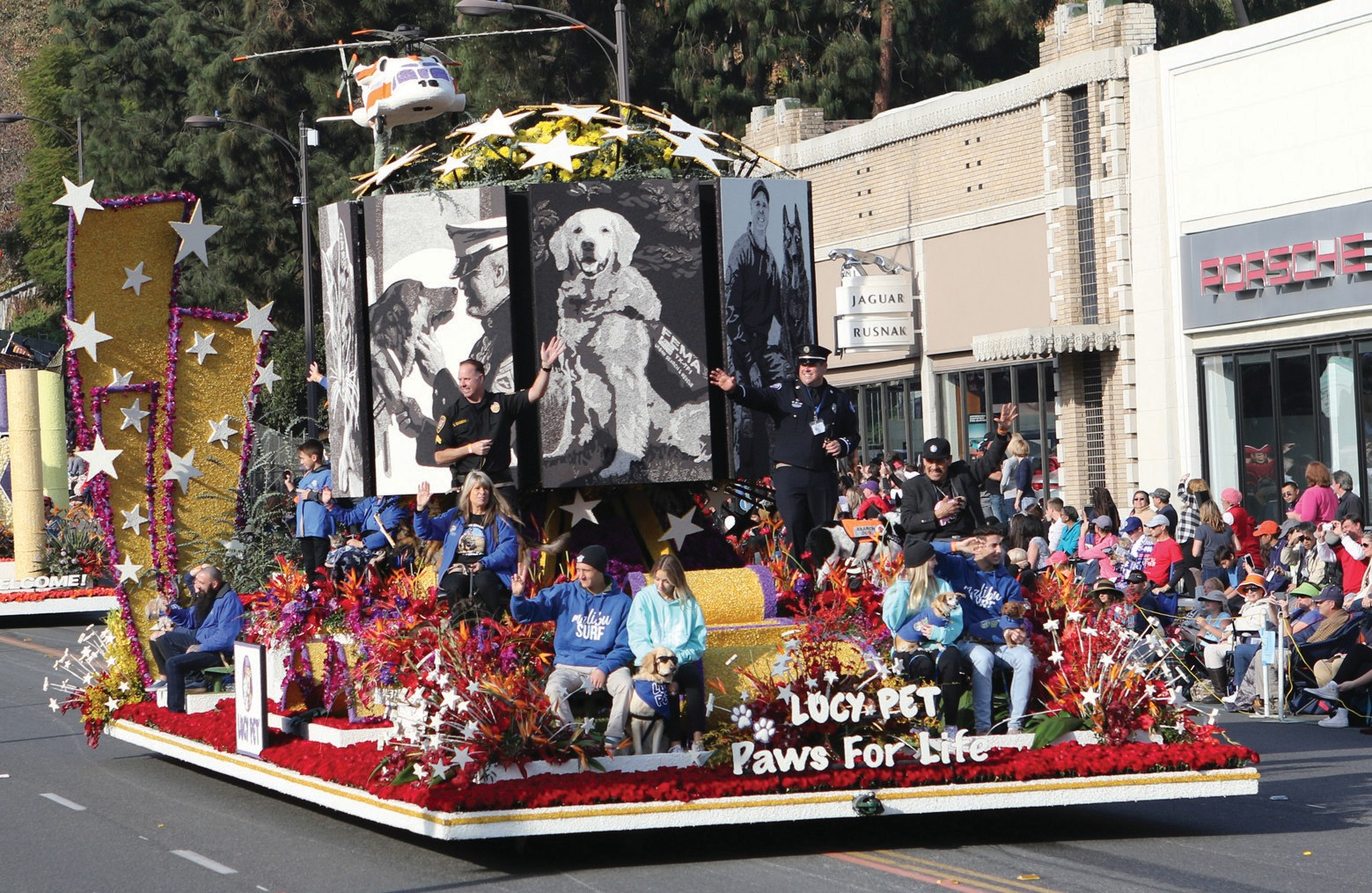 HOPE FLOATS—Two views of the Lucy Pet Foundation'sfloat in this year's Rose Parade, an homage to special animals that make a difference in people's lives.