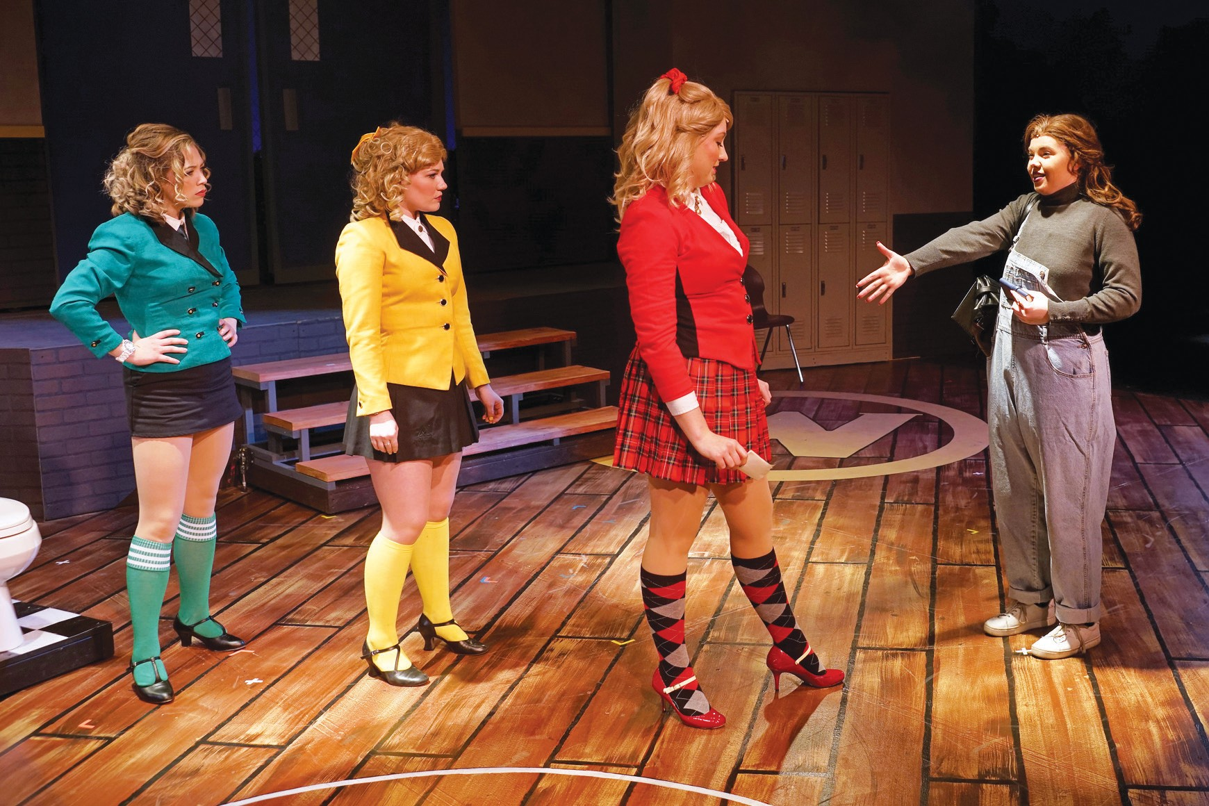 "GIRL GANG—From left, Shayde Bridges, Kate Fruehling and Karlee Squires—the Heathers—meet new recruit Veronica, played by Carly Jean Paul, in the YA4Ever's production of ""Heathers: The Musical."" Courtesy of Paul Cranmer"