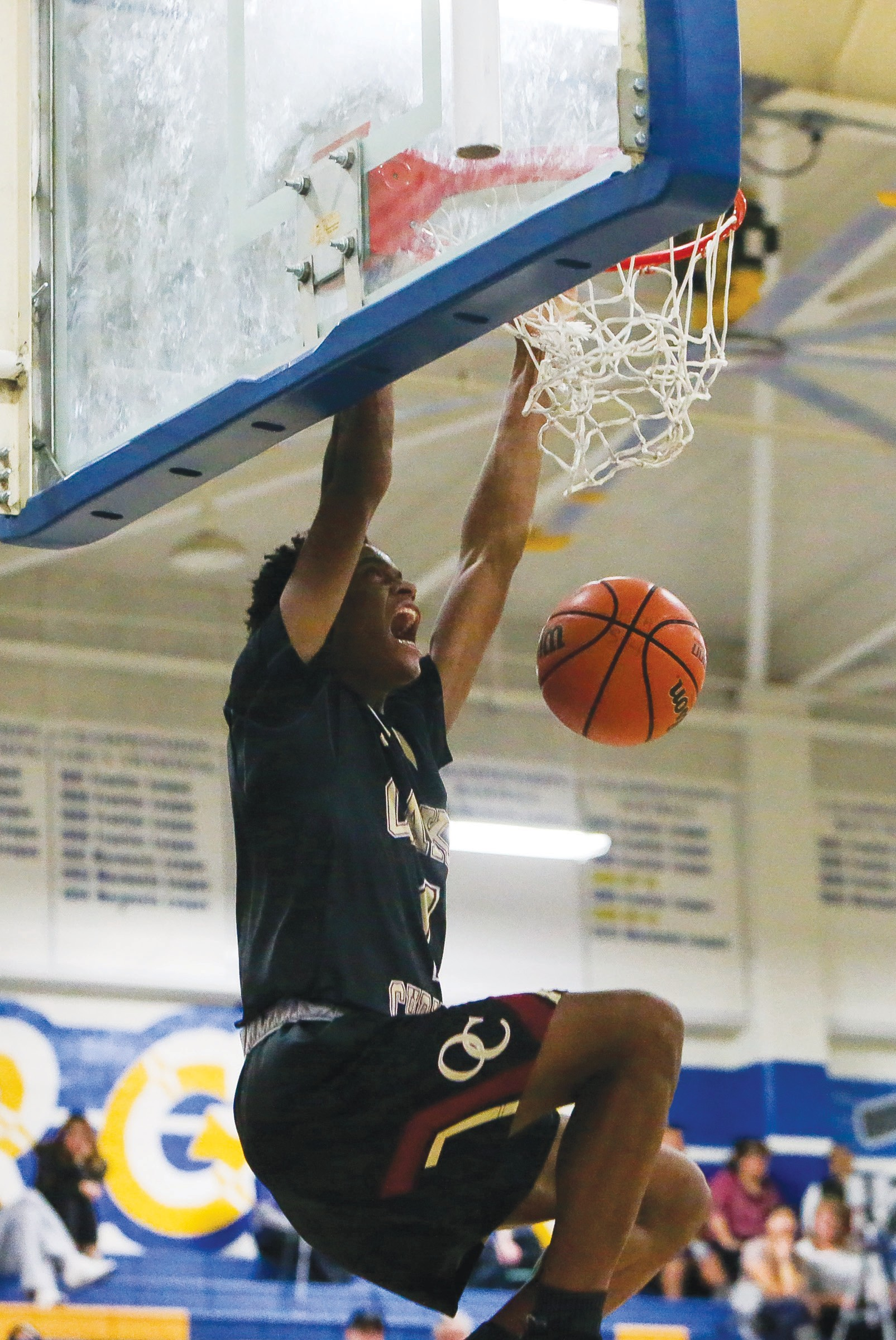 ROYAL FLUSH—Oaks Christian senior Talin Lewis dunks against Agoura. Lewis scored 12 points in the Marmonte League win.