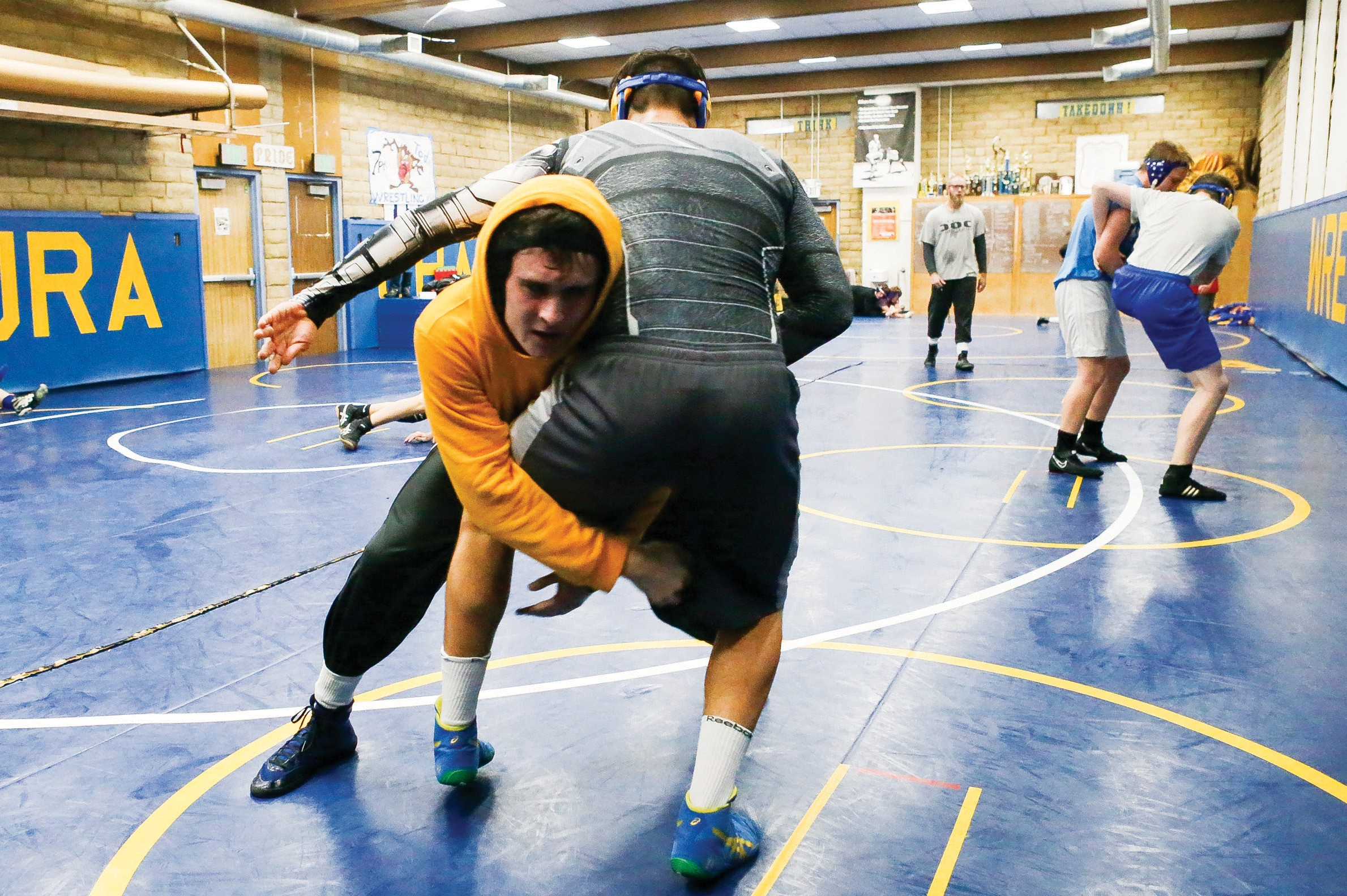SYSTEM OF A DOWN—Agoura High senior wrestler Brandon Sherwood, left, grapples with teammate Taylor Lazarus-Juareguy at practice earlier this week. Sherwood won a Marmonte League title last year. Photos by BOBBY CURTIS/Acorn Newspapers