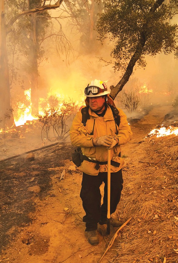 HOLD THE LINE—Steve Wallace fights the recent Thomas Fire as the blaze reaches the campus of Westmont College. Courtesy photo