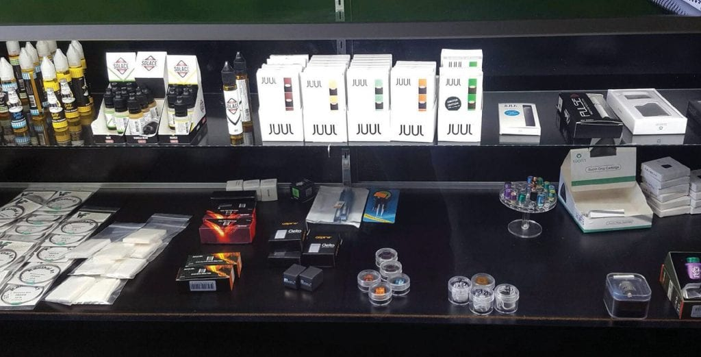 SMOKIN'—Vaping and e-cigarette products, including those from Juul, on display at a local shop. STEPHANIE BERTHOLDO/Acorn Newspapers