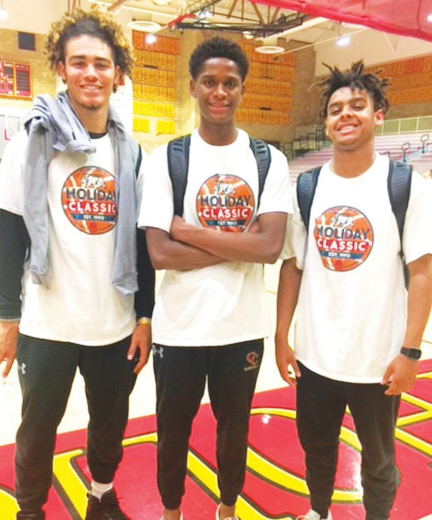 MUSIC MATES—From left, Oaks Christian students Jericho Parker, Talin Lewis and Max Harris get ready to shoot some hoops. All of their fathers work in the music industry and have won Grammy Awards. Courtesy photo