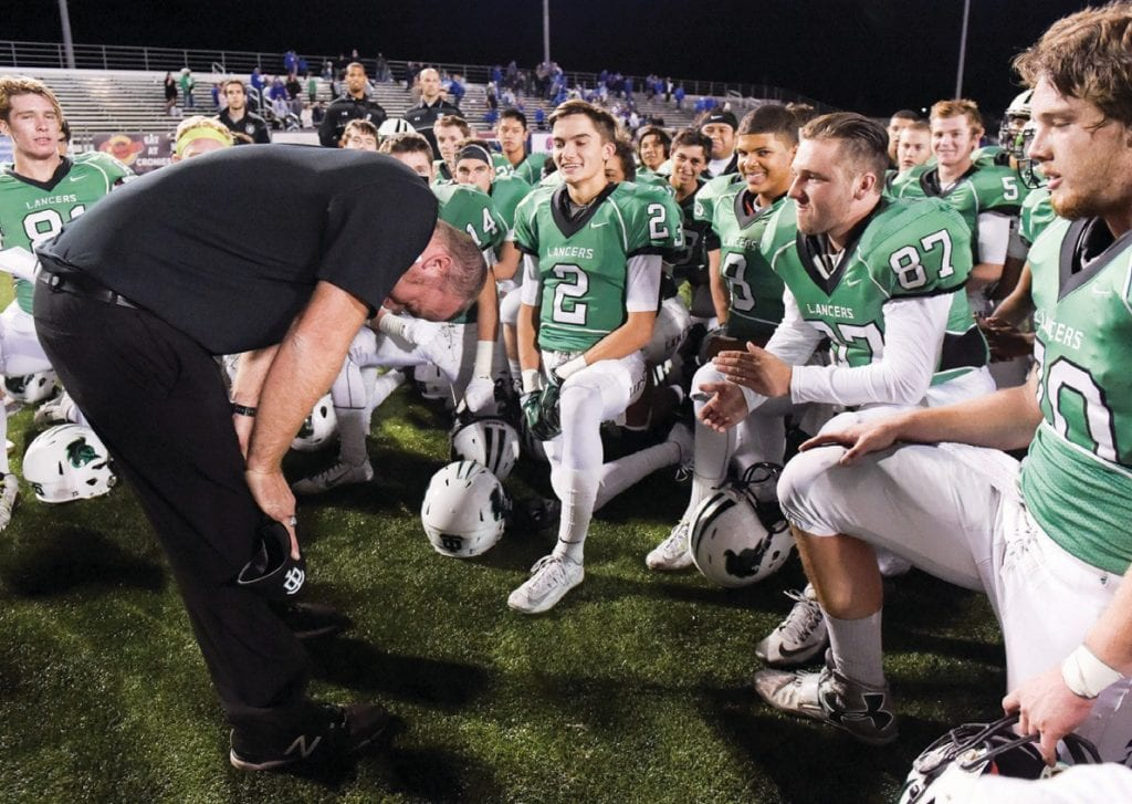 ANY GIVEN FRIDAY—Thousand Oaks High football head coach Mike Leibin takes a moment before talking with his players after a Lancer 34-31 playoff win in the CIF-SS Northern Division quarterfinals against Lompoc in 2015. Leibin stepped down as head coach last week. MICHAEL COONS/Acorn Newspapers