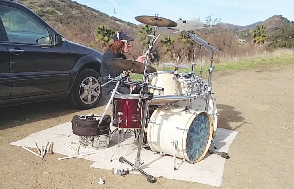ON THE ROAD—Robbie Gwartney of Thousand Oaks can often be seen playing his drums on weekends in a dirt lot on the side of the road near the corner of Kanan and Agoura. IAN BRADLEY/Acorn Newspapers