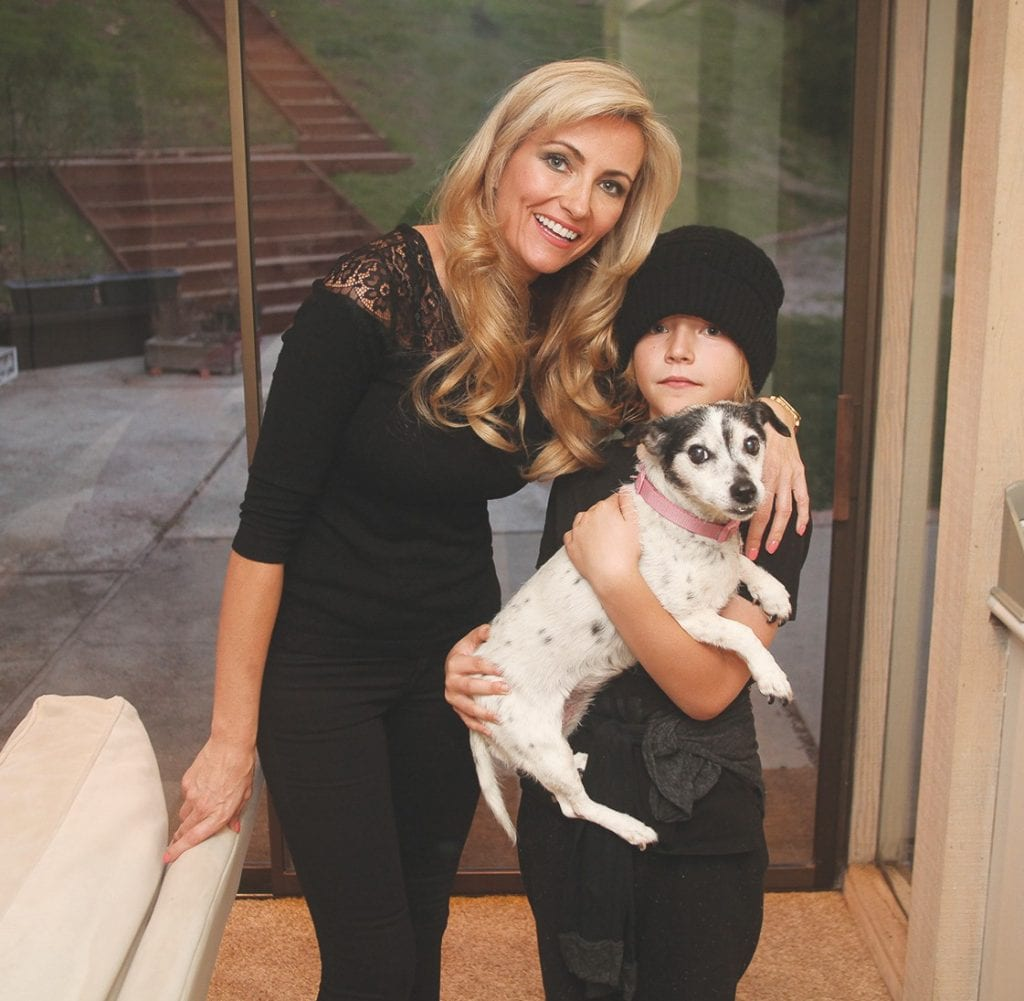 SCENE HERE—Nadine Young with her son Sammy, 8, and their 14-year-old Jack Russell terrier, Daisy, standing in front of the sliding glass door where the mountain lion tried to get in. RICHARD GILLARD/Acorn Newspapers