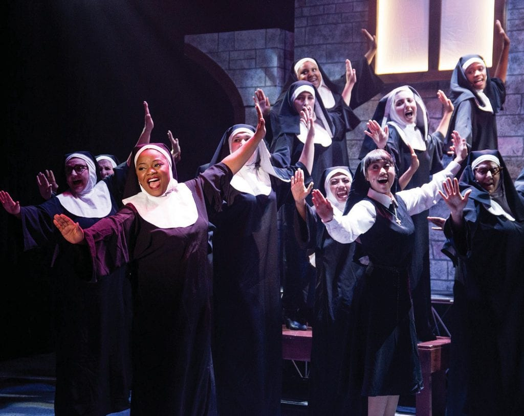 "IN HARMONY—Elizabeth Adabale, foreground, as Sister Mary Clarence, and company sing hallelujah in the musical ""Sister Act"" at the Simi Valley Cultural Arts Center through Feb. 18. Courtesy of Jon Neftali Photography"