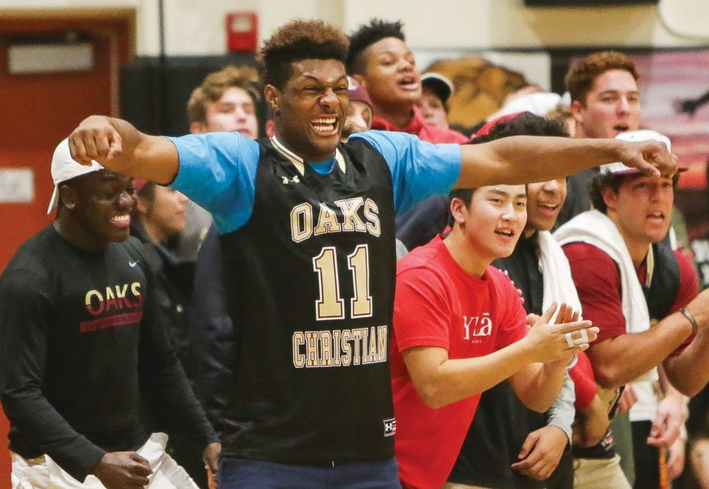 COME GET A TASTE—Kayvon Thibodeaux is the Oaks Christian High boys' basketball team's No. 1 fan. He's also a superstar defensive end for the CIF-Southern Section Division 2 championship football team. BOBBY CURTIS/Acorn Newspapers