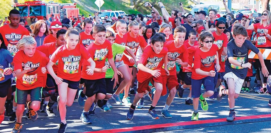 SPEEDSTERS—Kids break from the starting line during last year's Great Race of Agoura, set for March 24 this year. Acornfile photo