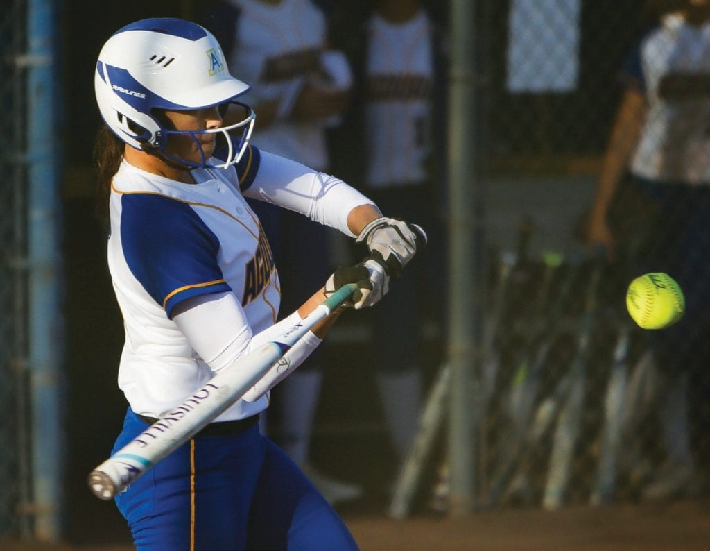 CONTACT—Agoura's Sami Demyon swings against Moorpark in the Feb. 27 season opener at home. Demyon went 2-for-2 with a double.
