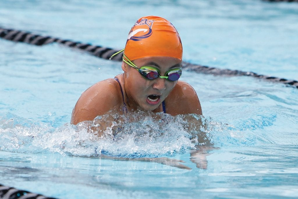 LIFE IN THE FAST LANE—Westlake High swimmer Melanie Zhang, a junior on the Warrior girls' team, competes in the breaststroke at the Spartan Relays on March 2 at Rio Mesa. Photos by BOBBY CURTIS/Acorn Newspapers