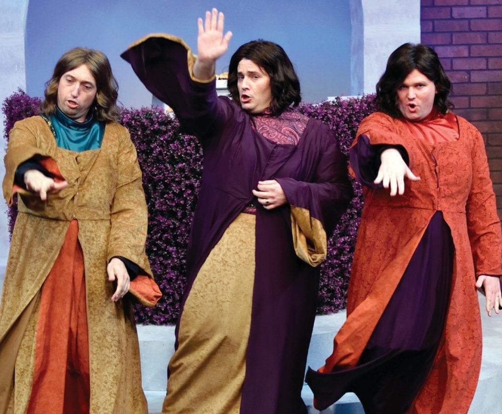 "SOME LIKE IT HOT—Florian (Anthony Moresi), Hilarion (Jonathan Matthews) and Cyril (Caleb Heulitt) as three unlikely ""female""students. Courtesy of John Pillsbury"