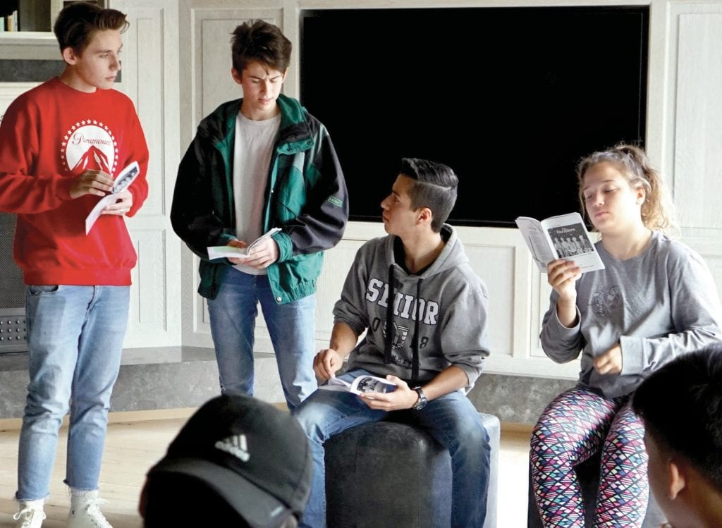 """ON STAGE—Young actors rehearse for the upcoming performance of """"The Outsiders,"""" a play produced, directed and acted by teens. Courtesy photo"""