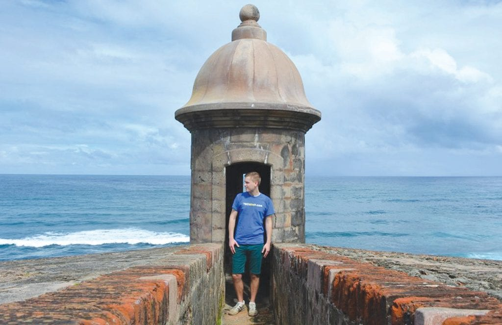 TO THE ENDS OF THE EARTH— At top, Meyer visits at the San Juan National Historic Site in San Juan, Puerto Rico. At right, his well-traveled map shows all the stops he's taken, including his latest to the Conejo Valley. Courtesy photos