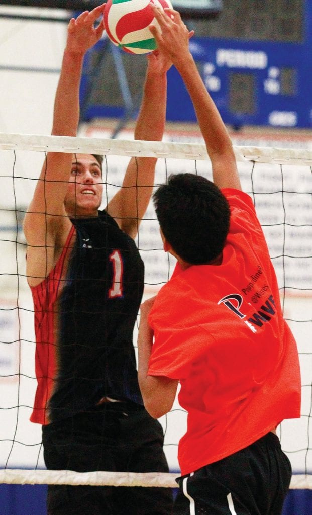 ALOHA—Westlake High boys' volleyball outside hitter Devon Johnson, a University of Hawaii commit, blocks the ball at practice. Photos by RICHARD GILLARD/Acorn Newspapers