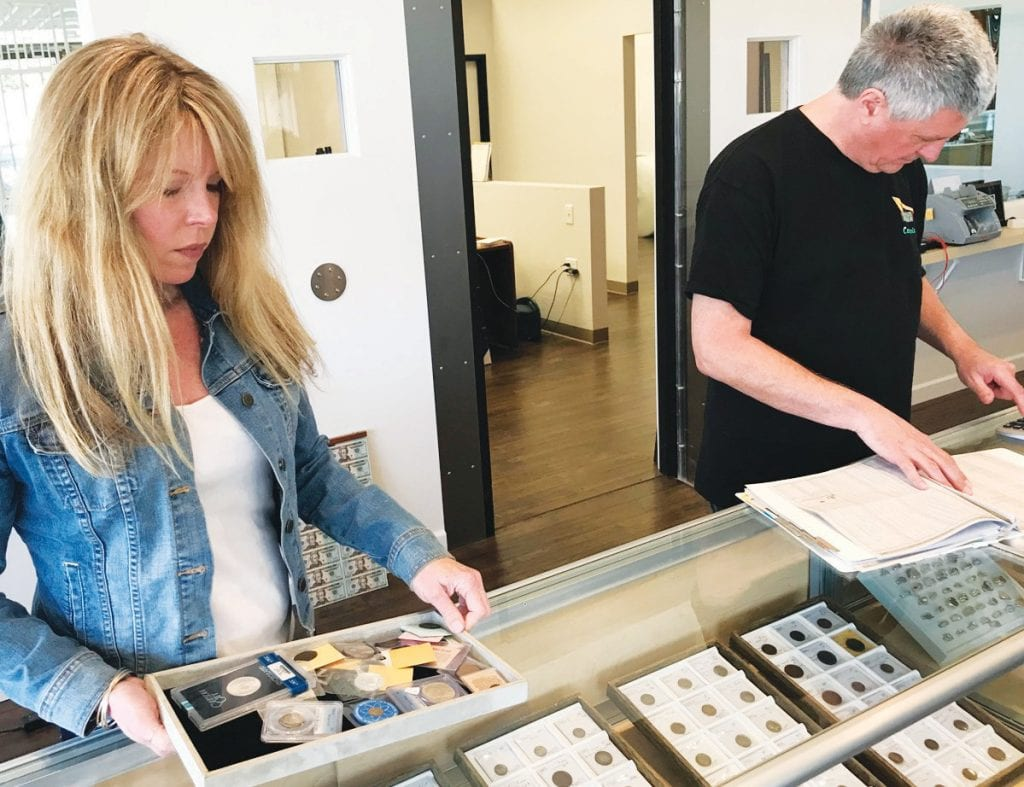 ON TOP OF IT—Lisa Lenk, left, keeps a close eye on the inventory at Goldcoast Coin Exchange in Agoura Hills.