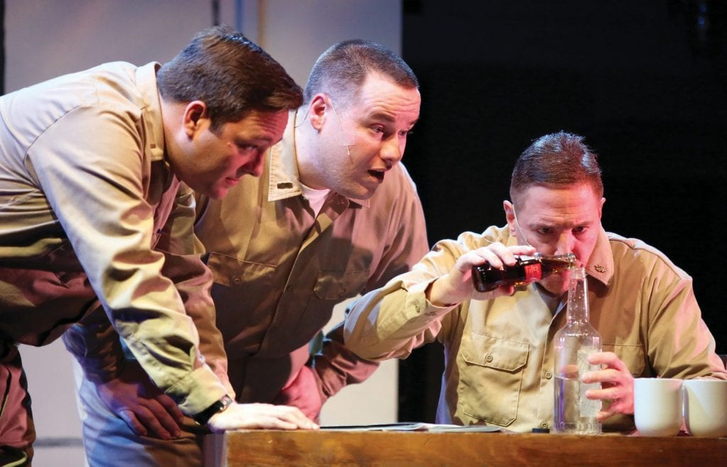 """BELOW DECK—From left, Doug Roberts (R. Shane Bingham), Ensign Pulver (Patrick Rogers) and Doc (Phil Nemy) concoct a batch of homemade scotch in """"Mister Roberts"""" at the High Street Arts Center. Courtesy of Barbara Mazeika"""