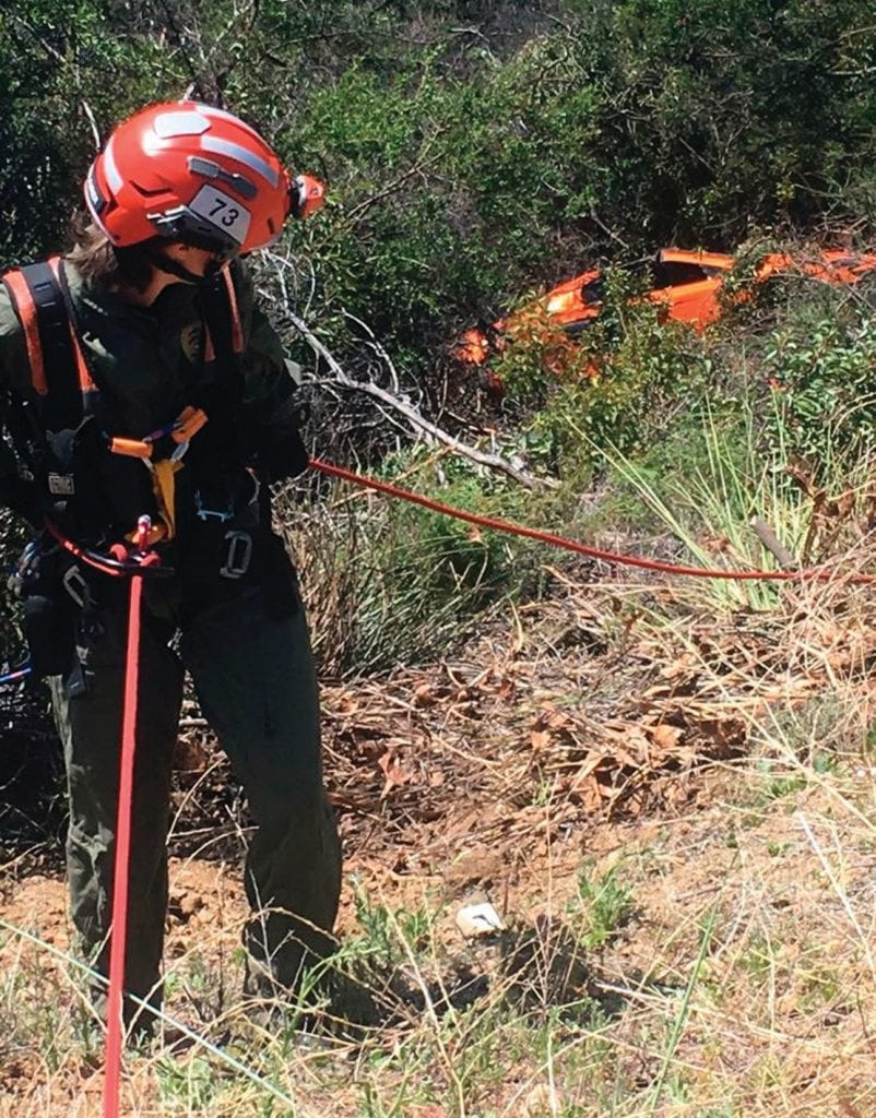 """DOWN AND OUT—Rescue workers extract what was reported to be a very expensive McLaren F1 sports car from a ravine off Latigo Canyon Road near Malibu April 28. A witness reportedly told officials the driver of the vehicle was racing on the curvy road, and that after the wreck occurred he climbed up the hillside, got into another car and left the scene. The name of the owner hasn't been released. """"It's a big problem,"""" Malibu Search and Rescue leader Dave Katz told The Acorn. """"People come with fast cars that they control and endanger others."""" Courtesy of Malibu SAR"""