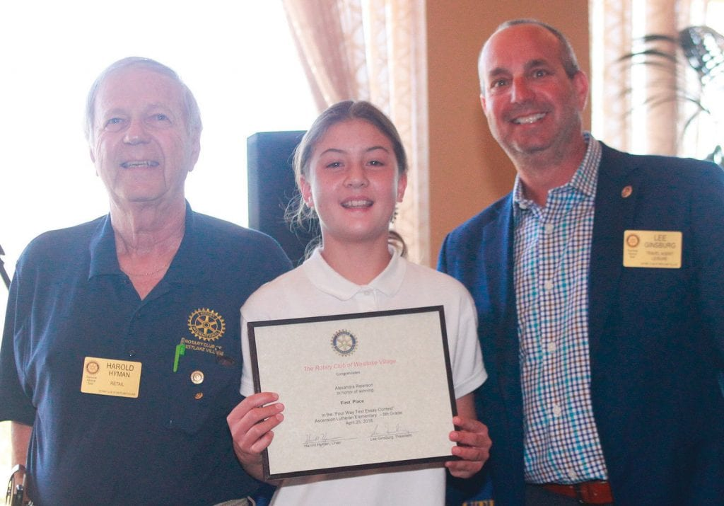 AWARDEES—The Rotary Club of Westlake Village's Four-Way Test Essay Contest award ceremony honors the winners April 25 at the North Ranch Country Club. Above, Ascension Lutheran Schoolfifth-grader Alexandra Reierson with Harold Hyman and Lee Ginsburg. Below, Acacia Elementary School fourth-grader Katie Pregitzer reads her essay. Photos by RICHARD GILLARD/Acorn Newspapers